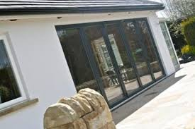 Grey on White aluminum Bi-Folding Doors Bury